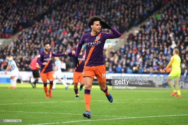 Leroy Sane of Manchester City celebrates after he scores his sides third goal during the Premier League match between Huddersfield Town and...