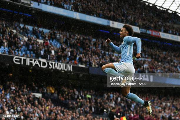 Leroy Sane of Manchester City celebrates after scoring a goal to make it 50 during the Premier League match between Manchester City and Liverpool at...