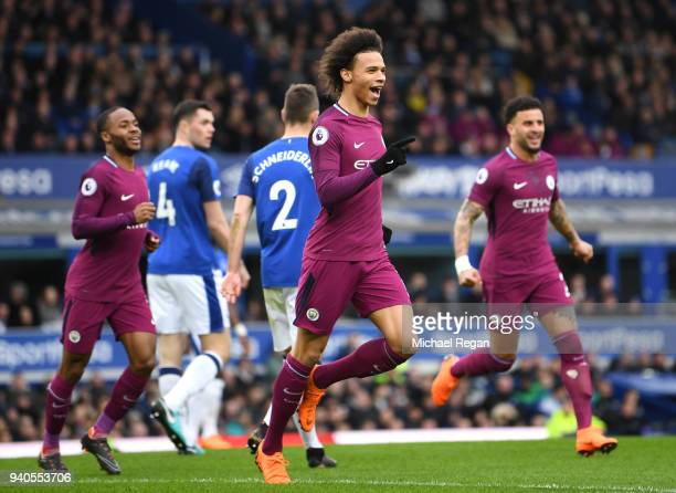 Leroy Sane of Manchester City celebrates after scoring his sides first goal during the Premier League match between Everton and Manchester City at...