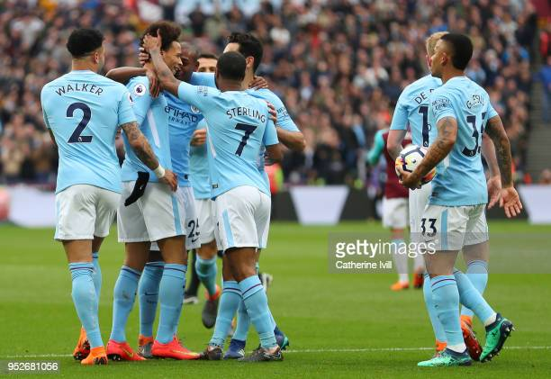 Leroy Sane of Manchester City celebrates after scoring his sides first goal with his Manchester City team mates during the Premier League match...