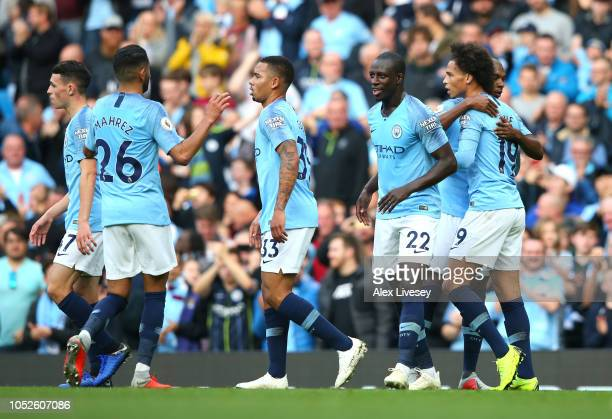Leroy Sane of Manchester City celebrates after scoring his team's fifth goal with his team mates during the Premier League match between Manchester...