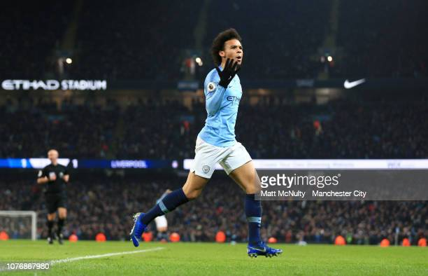 Leroy Sane of Manchester City celebrates after scoring his team's second goal during the Premier League match between Manchester City and Liverpool...