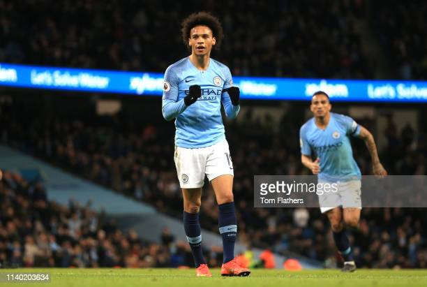 Leroy Sane of Manchester City celebrates after scoring his team's second goal during the Premier League match between Manchester City and Cardiff...