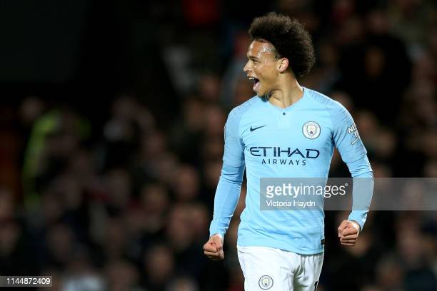 Leroy Sane of Manchester City celebrates after scoring his team's second goal during the Premier League match between Manchester United and...