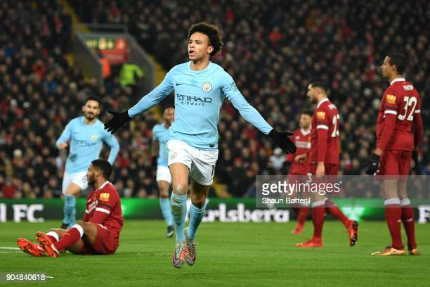 Leroy Sane of Manchester City celebrates after scoring the first Manchester City goal during the Premier League match between Liverpool and...