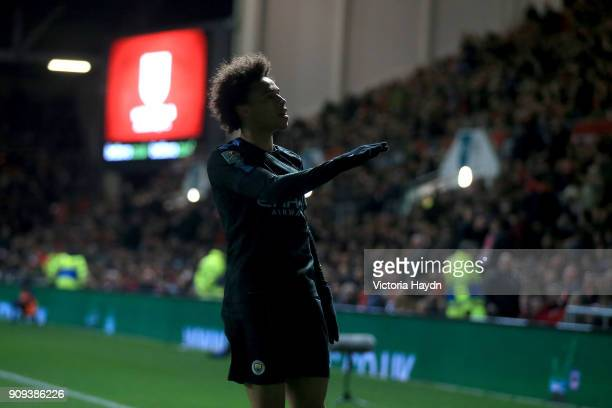 Leroy Sane of Manchester City celebrates as he scores their first goal during the Carabao Cup semifinal second leg match between Bristol City and...
