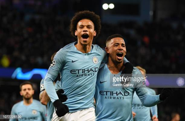 Leroy Sane of Manchester City celebrates scoring his sides first goal with Gabriel Jesus during the UEFA Champions League Group F match between...
