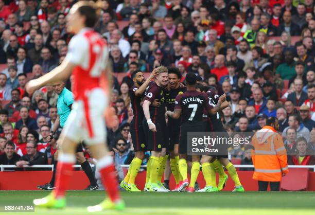 Leroy Sane of Manchester City celebrates scoring his sides first goal with his Manchester City team mates during the Premier League match between...