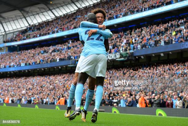 Leroy Sane of Manchester City celebrates scoring his sides fourth goal with Benjamin Mendy of Manchester City during the Premier League match between...