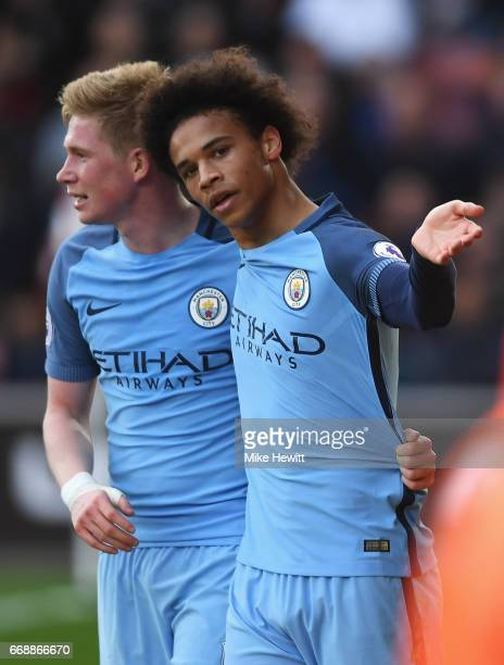 Leroy Sane of Manchester City celebrates scoring his sides second goal with Kevin De Bruyne of Manchester City during the Premier League match...