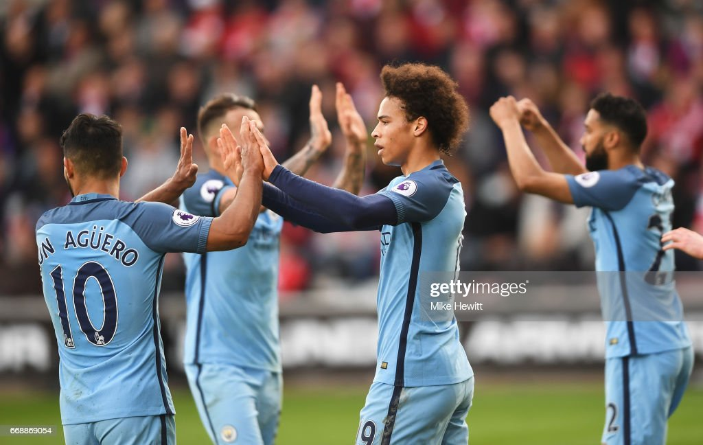 Leroy Sane of Manchester City celebrates scoring his sides second goal with Sergio Aguero of Manchester City during the Premier League match between Southampton and Manchester City at St Mary's Stadium on April 15, 2017 in Southampton, England.