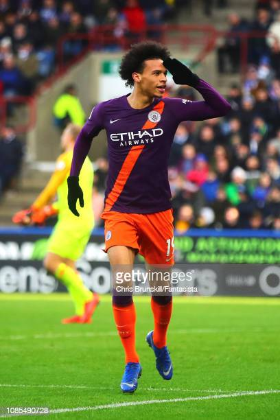 Leroy Sane of Manchester City celebrates scoring his side's third goal during the Premier League match between Huddersfield Town and Manchester City...