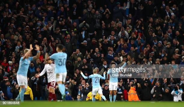 Leroy Sane of Manchester City celebrates scoring his team's third goal during The Emirates FA Cup Third Round match between Manchester City and...