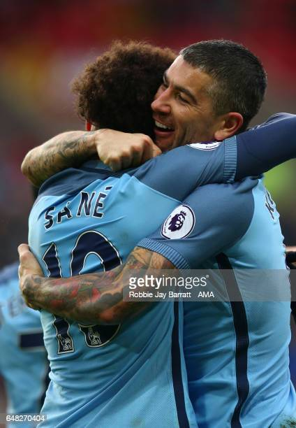 Leroy Sane of Manchester City celebrates scoring the second goal to make the score 02 with Aleksandar Kolarov during the Premier League match between...