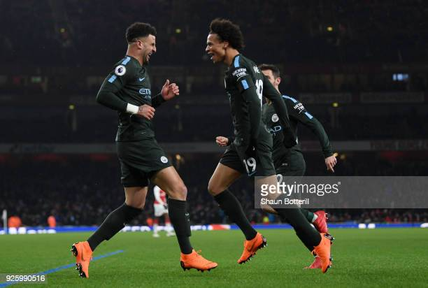Leroy Sane of Manchester City celebrates the third goal with Kyle Walker during the Premier League match between Arsenal and Manchester City at...