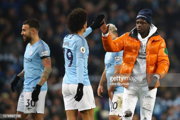 Leroy Sane of Manchester City celebrates victory with Benjamin Mendy of Manchester City after the Premier League match between Manchester City and...