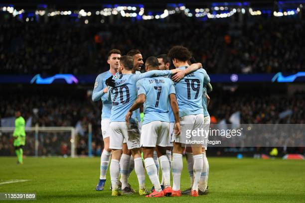 Leroy Sane of Manchester City celebrates with his teammates after he scores his sides third goal during the UEFA Champions League Round of 16 Second...