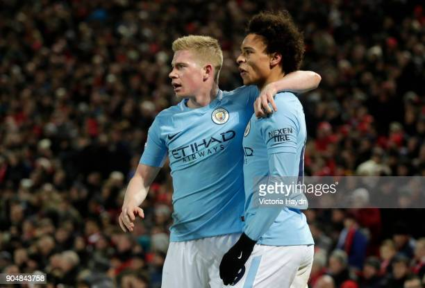 Leroy Sane of Manchester City celebrates with team mate Kevin De Bruyne after scoring the first Manchester City goal during the Premier League match...