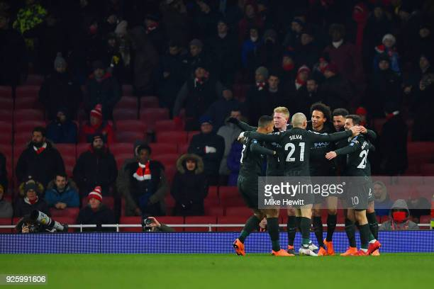 Leroy Sane of Manchester City celebrates with team mates after his goal to make it 30 during the Premier League match between Arsenal and Manchester...