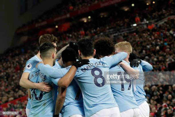 Leroy Sane of Manchester City celebrates with team mates after scoring the first Manchester City goal during the Premier League match between...