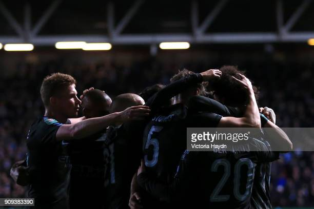 Leroy Sane of Manchester City celebrates with team mates as he scores their first goal during the Carabao Cup semifinal second leg match between...