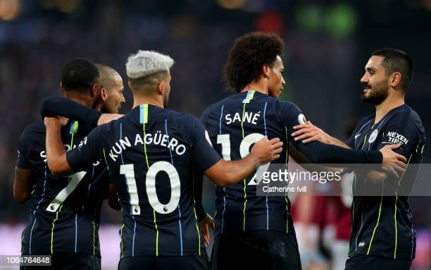 Leroy Sane of Manchester City celebrates with teammates after scoring his team's third goal during the Premier League match between West Ham United...