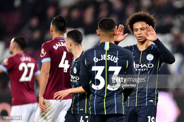 Leroy Sane of Manchester City celebrates with teammates after scoring his team's fourth goal during the Premier League match between West Ham United...