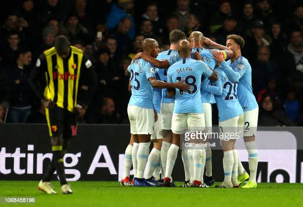 Leroy Sane of Manchester City celebrates with teammates after scoring his team's first goal during the Premier League match between Watford FC and...