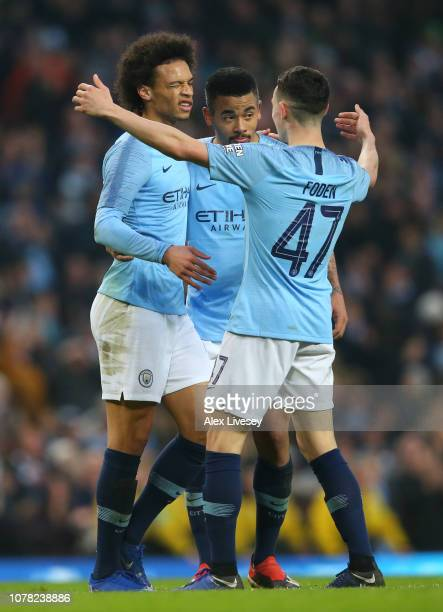 Leroy Sane of Manchester City celebrates with teammates after scoring his team's seventh goal during the FA Cup Third Round match between Manchester...