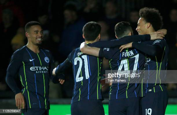 Leroy Sane of Manchester City celebrates with teammates after scoring his team's first goal during the FA Cup Fifth Round match between Newport...