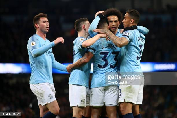 Leroy Sane of Manchester City celebrates with teammates after scoring his team's second goal during the Premier League match between Manchester City...