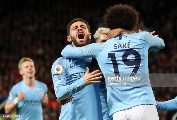 Leroy Sane of Manchester City celebrates with teammates Bernardo Silva and Sergio Aguero after scoring his team's second goal during the Premier...