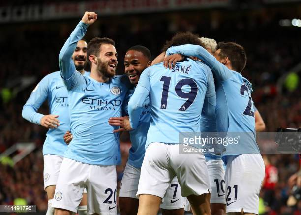 Leroy Sane of Manchester City celebrates with teammates Bernardo Silva and Raheem Sterling after scoring his team's second goal during the Premier...