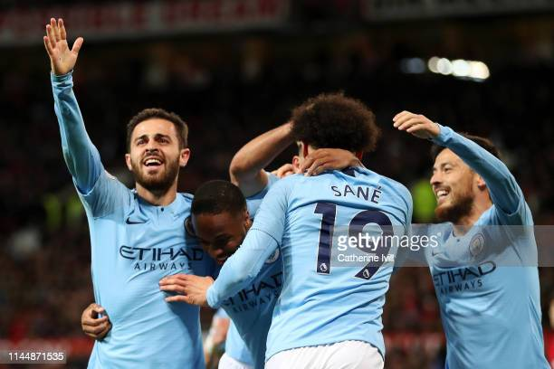 Leroy Sane of Manchester City celebrates with teammates David Silva Bernardo Silva Sergio Aguero and Raheem Sterling after scoring his team's second...
