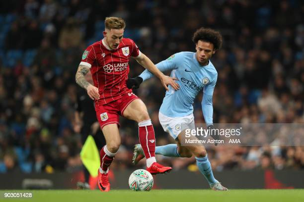 Leroy Sane of Manchester City competes with Josh Brownhill of Bristol City during the Carabao Cup SemiFinal first leg match between Manchester City...
