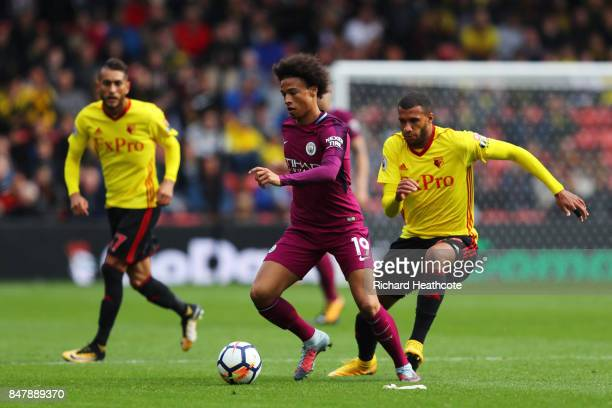 Leroy Sane of Manchester City gets away from Etienne Capoue of Watford during the Premier League match between Watford and Manchester City at...