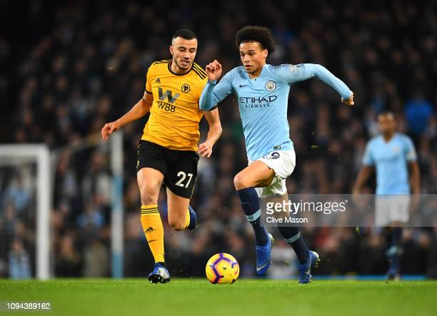 Leroy Sane of Manchester City gets away from Romain Saiss of Wolverhampton Wanderers during the Premier League match between Manchester City and...