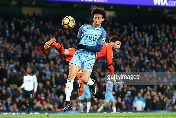 Leroy Sane of Manchester City gets to the ball before Hugo Lloris of Tottenham Hotspur and goes on to score his sides first goal during the Premier...