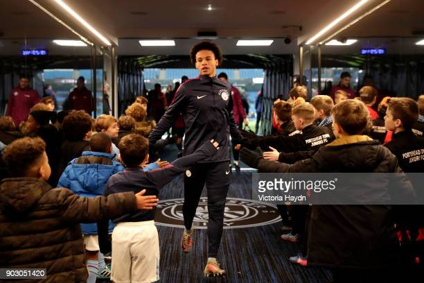 Leroy Sane of Manchester City greets mascots in the tunnel prior to the Carabao Cup SemiFinal First Leg match between Manchester City and Bristol...