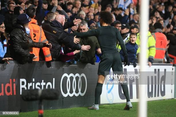 Leroy Sane of Manchester City hands his shirt to a fan after victory in the Carabao Cup semifinal second leg match between Bristol City and...