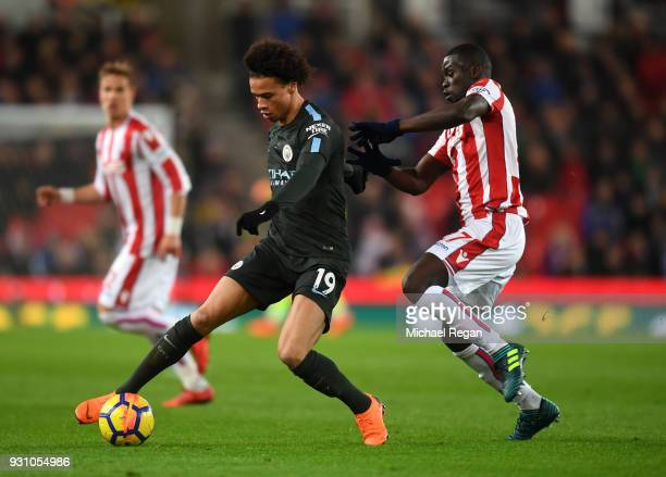 Leroy Sane of Manchester City holds off Badou Ndiaye of Stoke City during the Premier League match between Stoke City and Manchester City at Bet365...