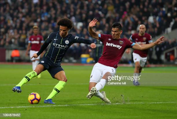 Leroy Sane of Manchester City holds off Fabian Balbuena of West Ham United during the Premier League match between West Ham United and Manchester...