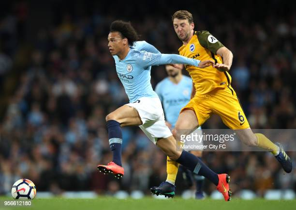 Leroy Sane of Manchester City is challenged by Dale Stephens of Brighton and Hove Albion during the Premier League match between Manchester City and...
