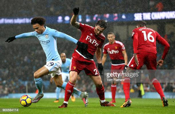 Leroy Sane of Manchester City is challenged by Daryl Janmaat of Watford during the Premier League match between Manchester City and Watford at Etihad...