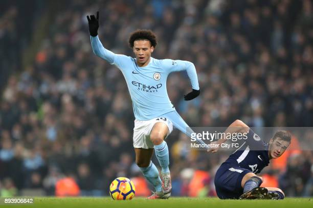 Leroy Sane of Manchester City is challenged by Harry Winks of Tottenham Hotspur during the Premier League match between Manchester City and Tottenham...