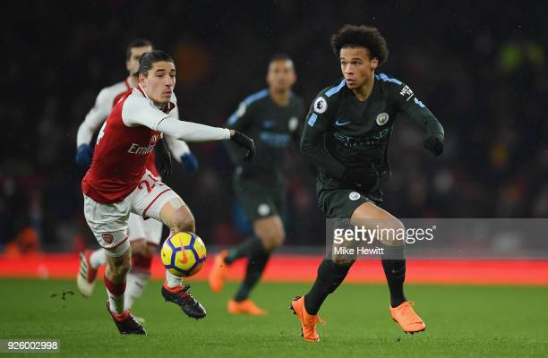 Leroy Sane of Manchester City is challenged by Hector Bellerin during the Premier League match between Arsenal and Manchester City at Emirates...