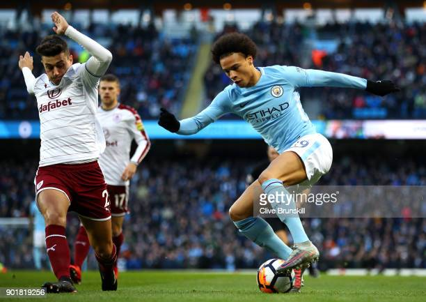 Leroy Sane of Manchester City is challenged by Matthew Lowton of Burnley during The Emirates FA Cup Third Round match between Manchester City and...