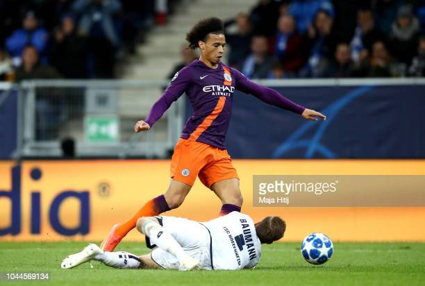 Leroy Sane of Manchester City is challenged by Oliver Baumann of 1899 Hoffenheim inside the penalty area during the Group F match of the UEFA...