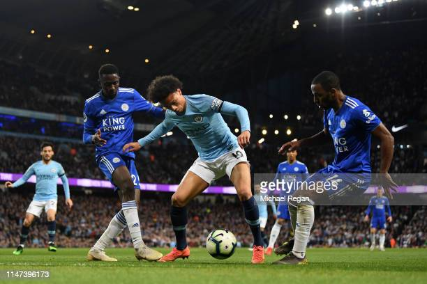Leroy Sane of Manchester City is challenged by Onyinye Wilfred Ndidi of Leicester City and Ricardo Pereira of Leicester City during the Premier...