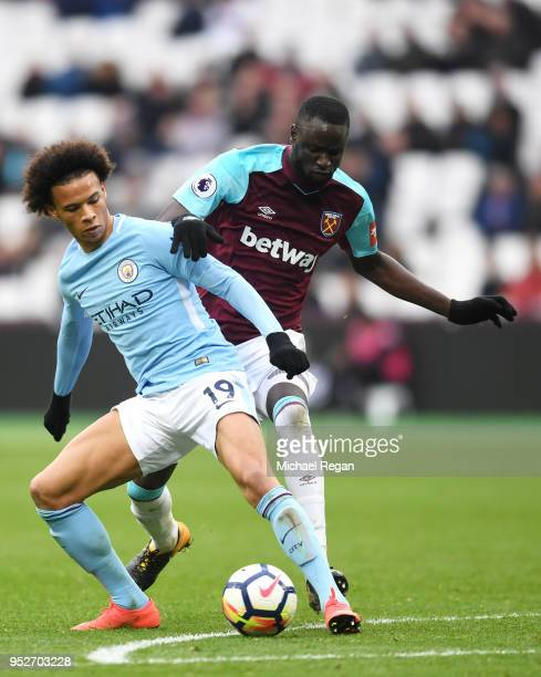 Leroy Sane of Manchester City is challenged by Pedro Obiang of West Ham United during the Premier League match between West Ham United and Manchester...